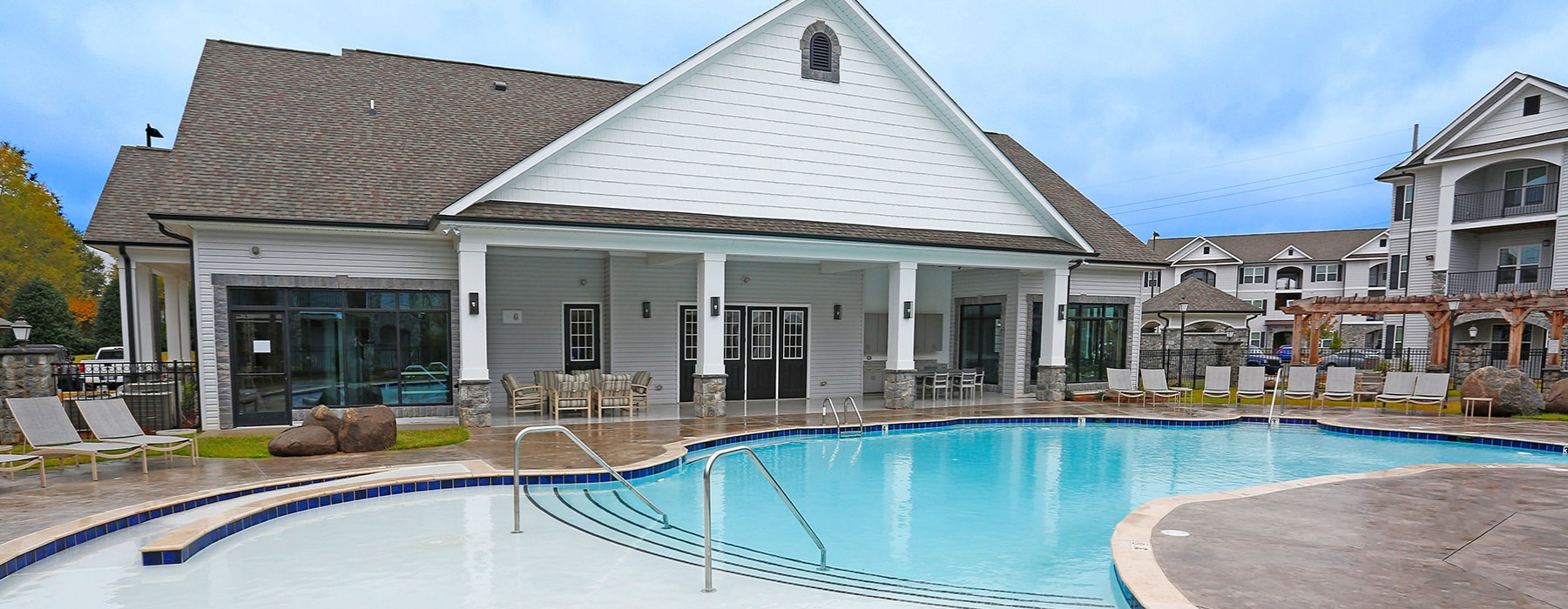 Swimming Pool With Plenty of Deck Seating At Laurel View Apartments in Concord, NC