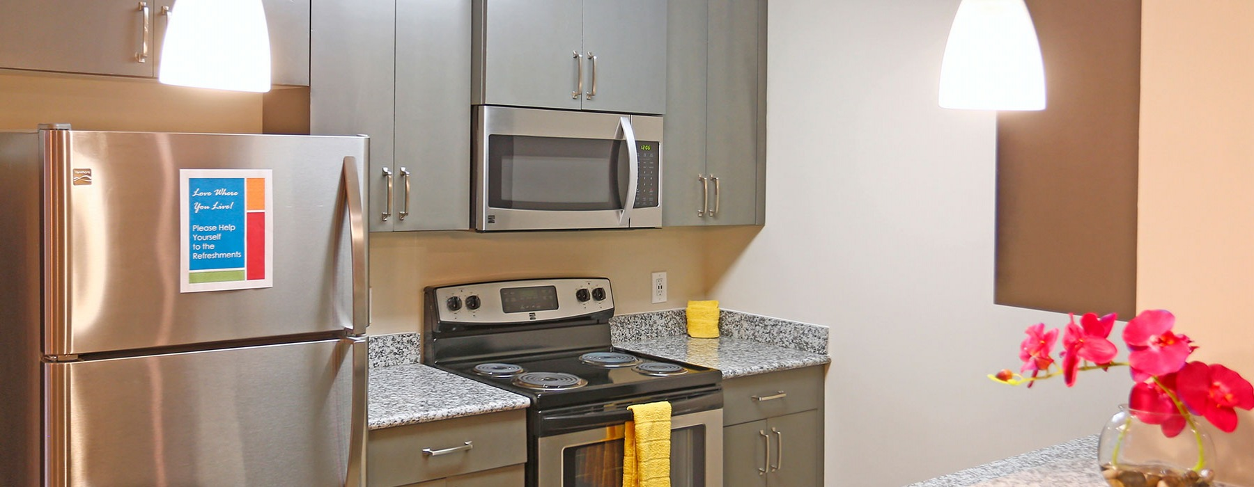 Modern Kitchen With Stainless Steel Appliances & Grey Cabinets At Laurel View Apartments in Concord, NC