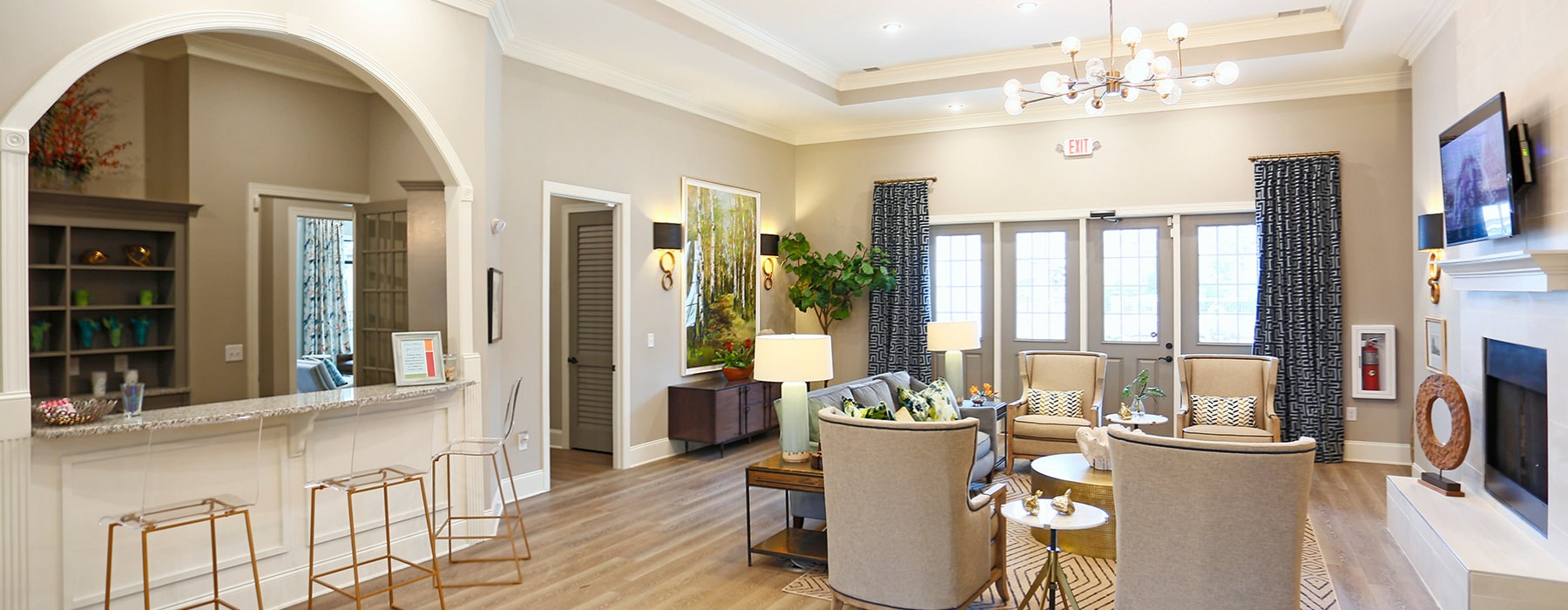 Well Lit Resident Lounge With Comfortable Seating & Wood Floors At Laurel View Apartments in Concord, NC